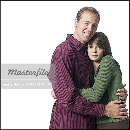 Man and girl embracing