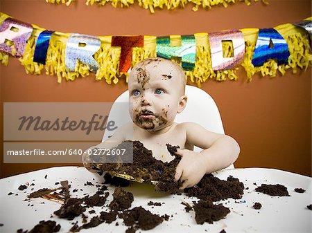 Amazing Baby Eating Birthday Cake Stock Photo Masterfile Premium Funny Birthday Cards Online Hendilapandamsfinfo