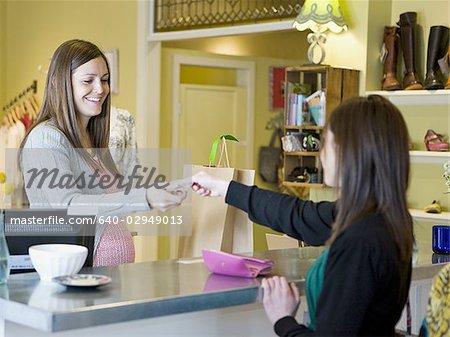 ec443819c4e pregnant clothing store clerk - Stock Photo - Masterfile - Premium ...
