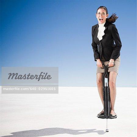 businesswoman on a pogo stick