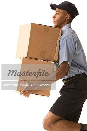 Deliveryman holding two parcels