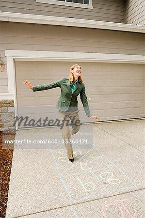 Woman playing hopscotch