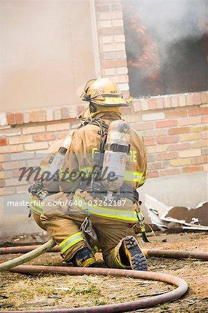 Rear View of firefighter in smoke
