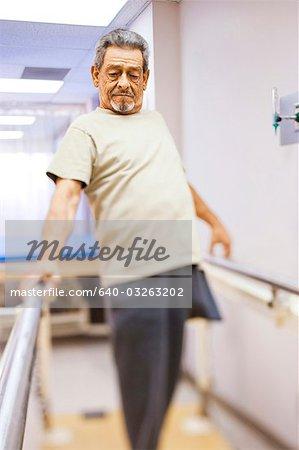 Older man with one leg walking