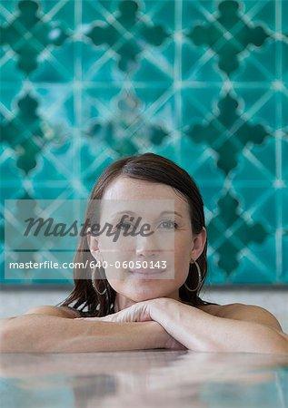 Italy, Amalfi Coast, Ravello, Portrait of mature woman in swimming pool