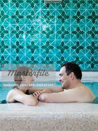 Italy, Amalfi Coast, Ravello, Mature couple in swimming pool