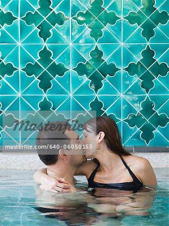 Italy, Amalfi Coast, Ravello, Mature couple kissing in swimming pool