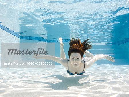 USA, Utah, Orem, Smiling woman swimming in swimming pool