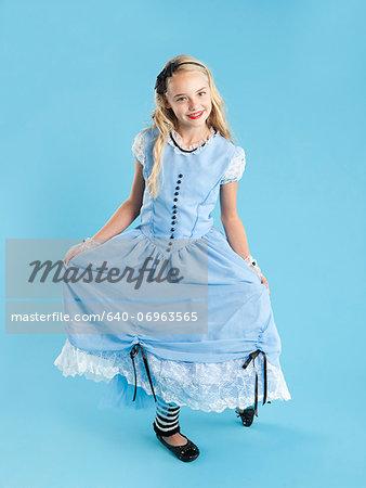 Portrait of girl (10-11) in Alice in Wonderland costume for Halloween