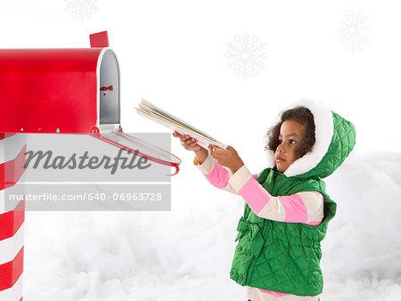 Girl (4-5) sending letter to Santa