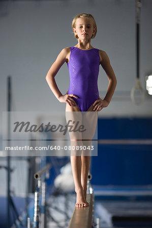 USA, Utah, Orem, girl gymnast (8-9) on balance beam