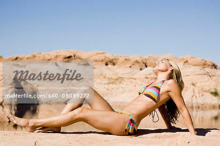 woman sunbathing at the lake