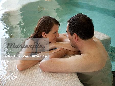 Italy, Amalfi Coast, Ravello, Mature couple relaxing in swimming pool