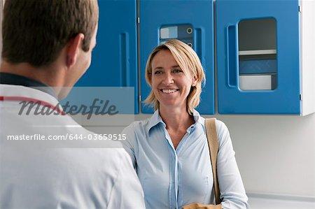 Happy patient visiting doctor