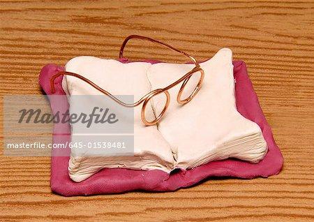 Eyeglasses on an open book