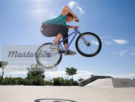Teen boy on bike jumping