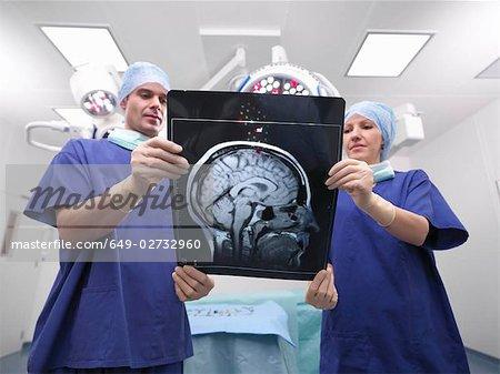 Nurses looking at x-ray