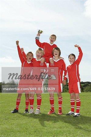 Football team holding trophy