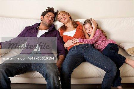 tired family asleep