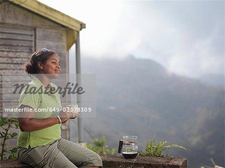 Female Coffee Worker Drinking Coffee