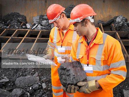 Coal Workers Inspecting Coal