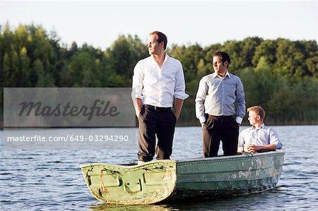three businessmen in rowboat