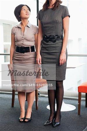 Short women looking at tall women