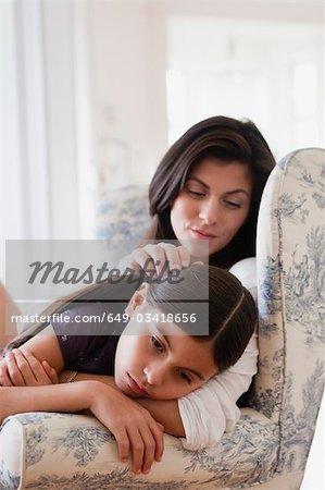 mother caressing daughter