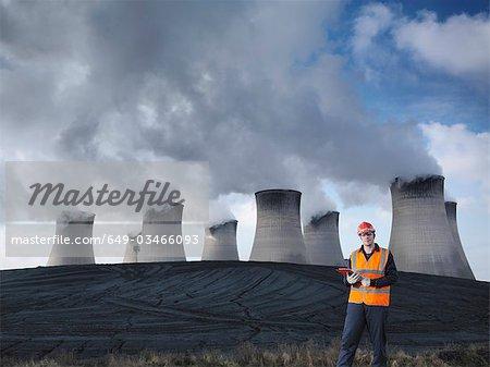Worker Inspecting Coal Store