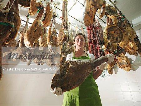 Woman holding a ham leg