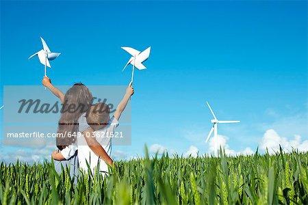 Boy and girl with wind turbine