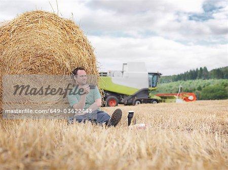 Farmer taking a break during harvesting