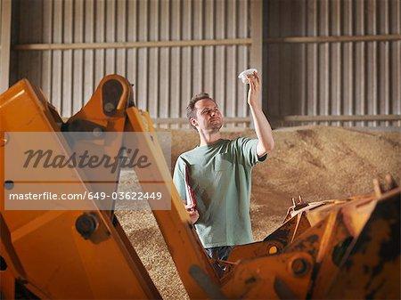 Farmer with a sample of grain