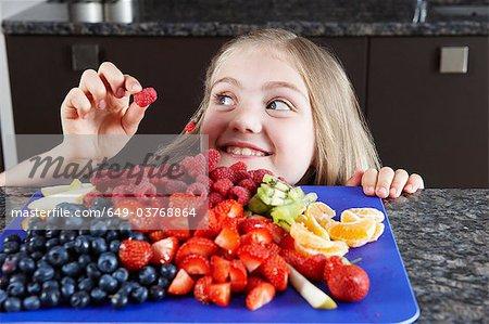 Girl choosing some fruit