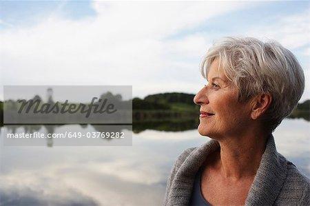 Senior woman watching sunset