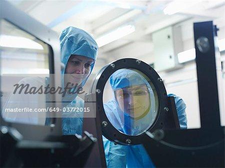 Scientists inspecting laser filter