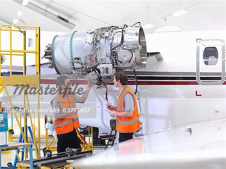 Engineers with jet engine