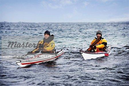Two men kayaking