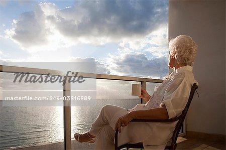 Senior Woman watching sunrise