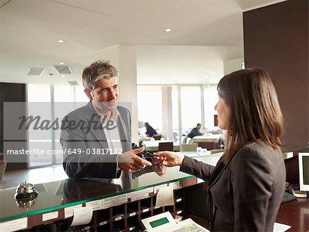 A Senior man receiving his Hotel Room Key