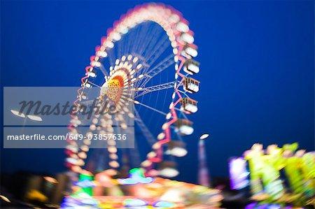 Ferris wheel lit up against night sky
