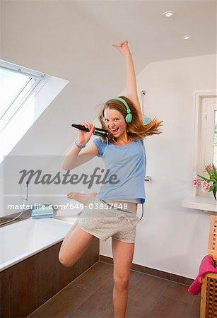 Girl singing in bathroom
