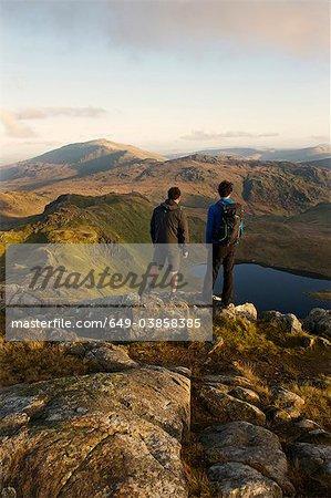 Men admiring mountain view