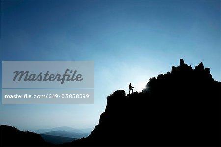 Man hiking on rocky hillside