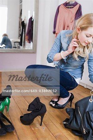 Woman searching through purse