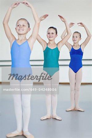 Ballet dancers posing in studio
