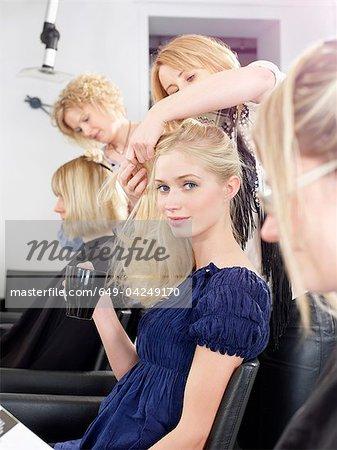 Woman having hair cut in salon
