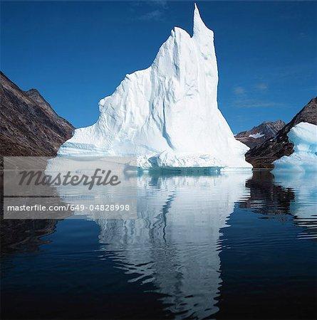 Glacier in lake under blue sky