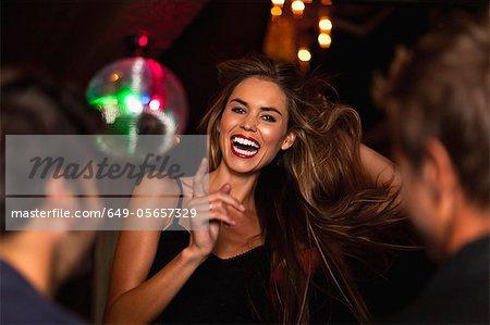 Smiling woman dancing in club