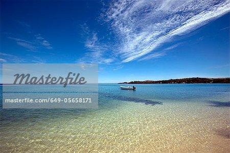 Boat in still ocean